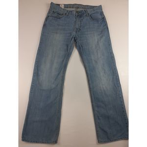 AMERICAN EAGLE LOW RISE BOOT CUT DISTRESSED JEANS